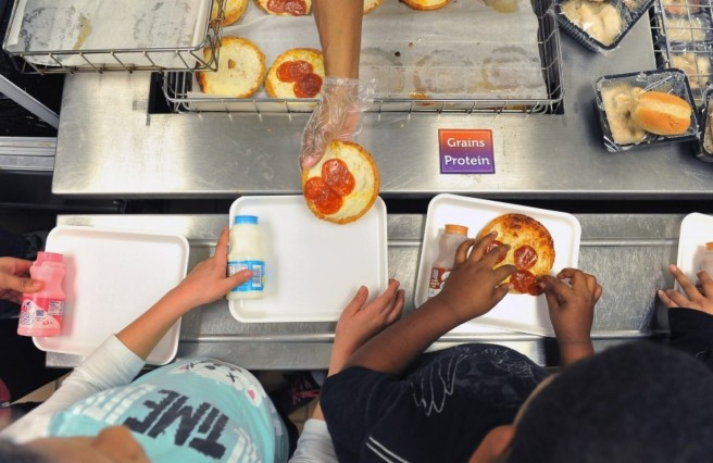 Children are served lunch at Broad Acres Elementary School in Silver Spring, Md., in 2012. Of the 708 students at the school during that year, 95 percent qualified for a free or reduced-price lunch because of low family income. (Matt McClain for The Washington Post)